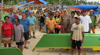 Turning piles of wood into livelihood: USTHS Batch 1969 donates 45 fishing boats to Gigantes Island and Estancia fishermen!