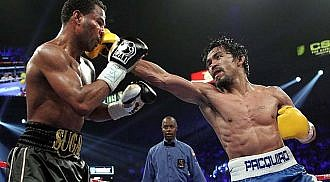 Manny Pacquiao punches way to greatness