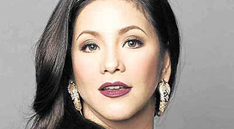 Regine puts behind controversial 'issue' with DFA chief