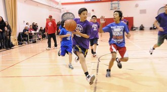 The 21st Annual IKAW Basketball for Kids in full swing