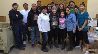 "QPAM celebrates ""Kapit-Bisig"" volunteerism at Winnipeg Harvest"