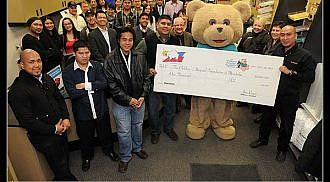 MFBC donates supersized cheque to the Children's Hospital Foundation