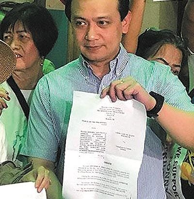 Trillanes returns from US, posts bail for sedition case