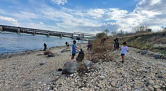 Filipino Anglers Association of Manitoba annual Red River Shoreline Cleanup